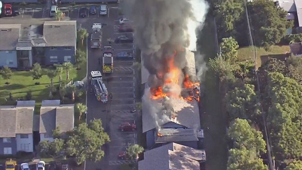 A fire is seen at the Royal Isles Apartments in Orlando on Wednesday. (Sky 13)
