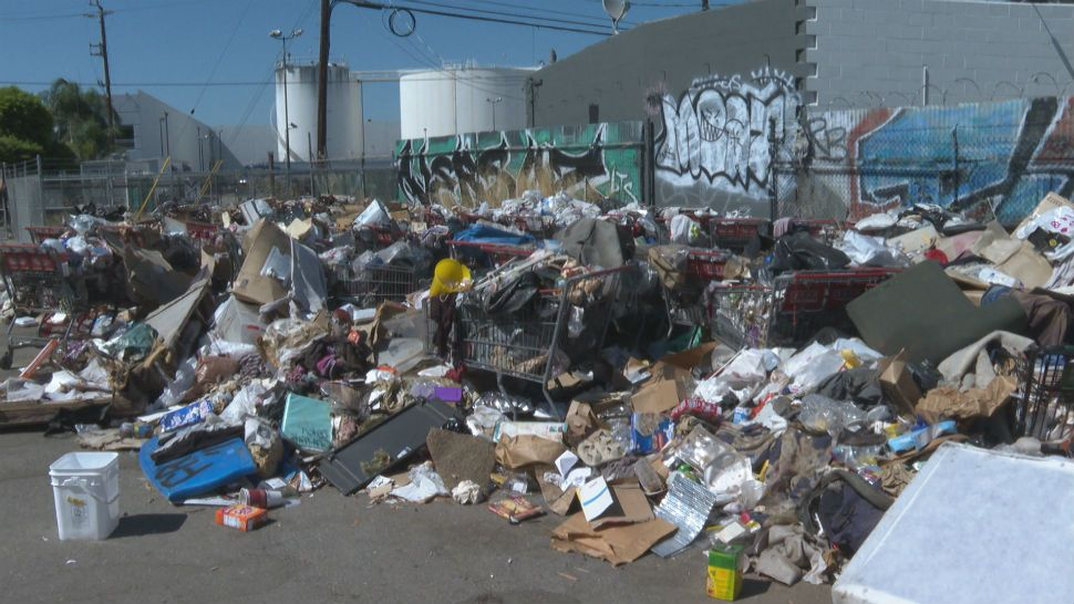 Homeless Camp Trash Pile Forms Due to Months of Neglect