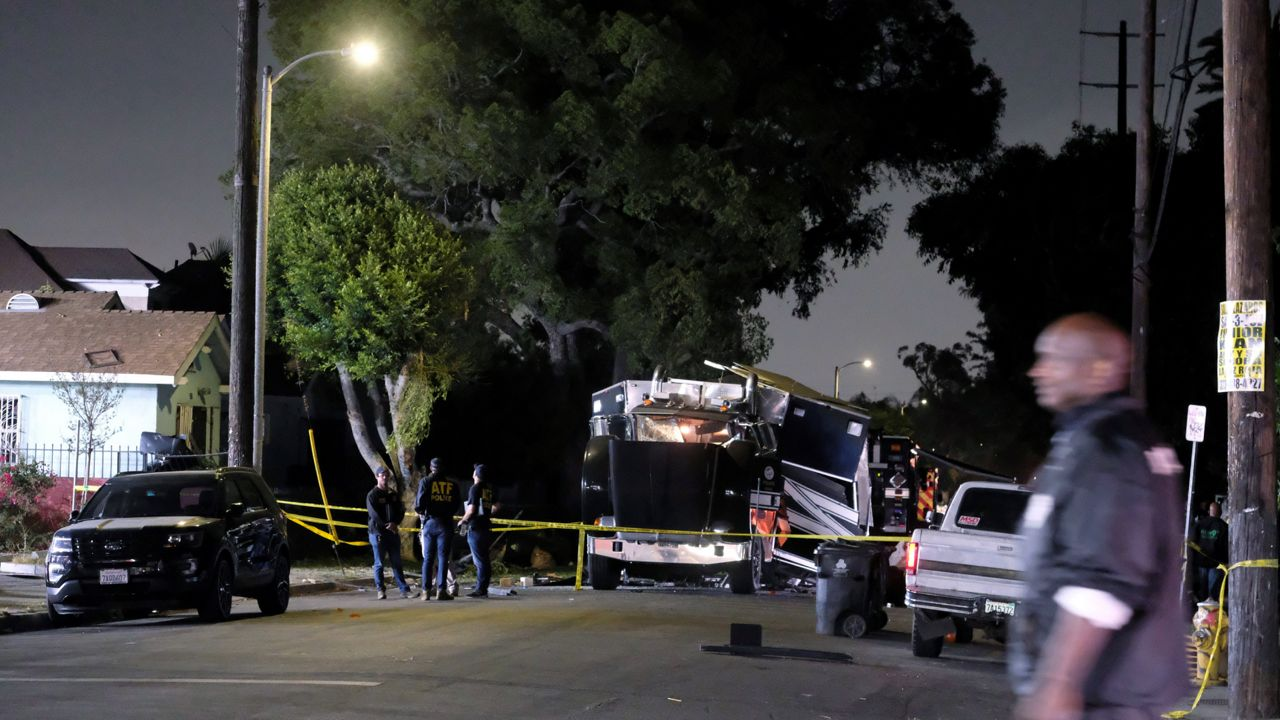 The remains of an armored Los Angeles Police Department tractor-trailer are seen after fireworks exploded Wednesday evening, June 30, 2021. (AP Photo/Ringo H.W. Chiu)