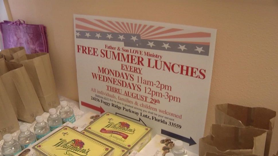 """Sandwiches, salads, and sweets are packed into lunch bags with a lot of love in the kitchen at """"Father and Son Love Worship Centre"""" in Lutz."""