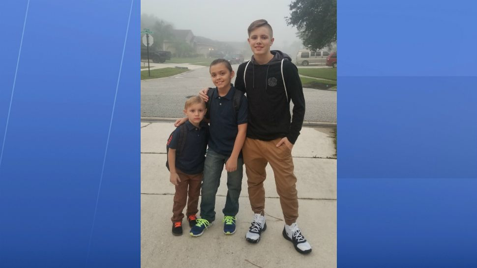 Sent to us with the Spectrum News 13 app: Gavin (kindergarten), Liam (5th grade), Caiden (9th grade) are ready to head back to school in Port Orange. (Katelyn Annis/viewer)