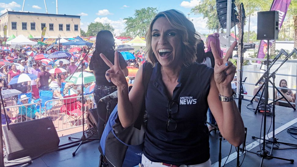 Spectrum News 13 anchor Ybeth Bruzual and Hispanic Beat reporter Jesse Canales greeted attendees at Latin Fiesta Nights at Old Town and helped them cool down with Spectrum News 13 water bottles.