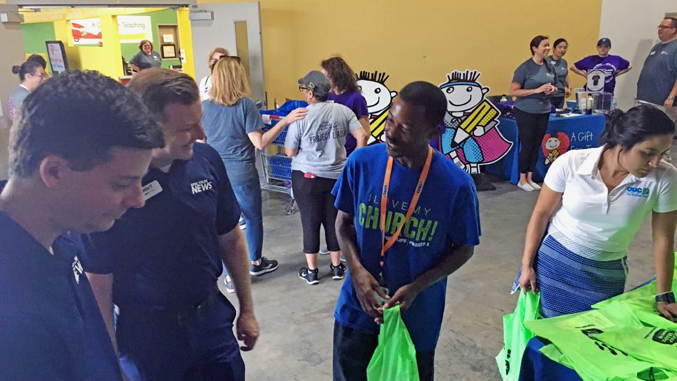 Spectrum News 13 meteorologist David Heckard and anchor Eric Levy, along with meteorologist Mallory Nicholls, welcomed about 300 teachers from Orange and Osceola counties back to school at A Gift for Teaching in Orlando.