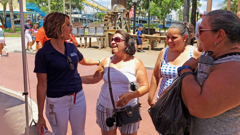 Spectrum News 13 anchor Ybeth Bruzual greeted attendees at Latin Fiesta Nights at Old Town and helped them cool down with Spectrum News 13 water bottles.