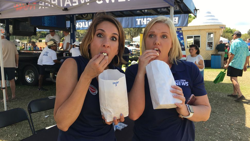 Spectrum News 13 joined 23,000 attendees at the Pig on the Pond festival in Clermont benefitting Project Scholars in March of 2019. Meteorologist Mallory Nicholls and anchor Ybeth Bruzual, enjoying a little snack, were just some of the news team who greeted families and festival goers and handed out Spectrum News 13 car phone chargers and Project Weather Activity Books.