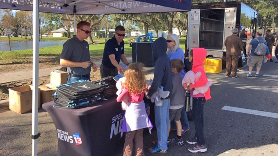 Spectrum News 13 reporter Asher Wildman and Chief Meteorologist Bryan Karrick greeted guests while photographer Ruben Almeida showed the live truck to kids who took the mic.