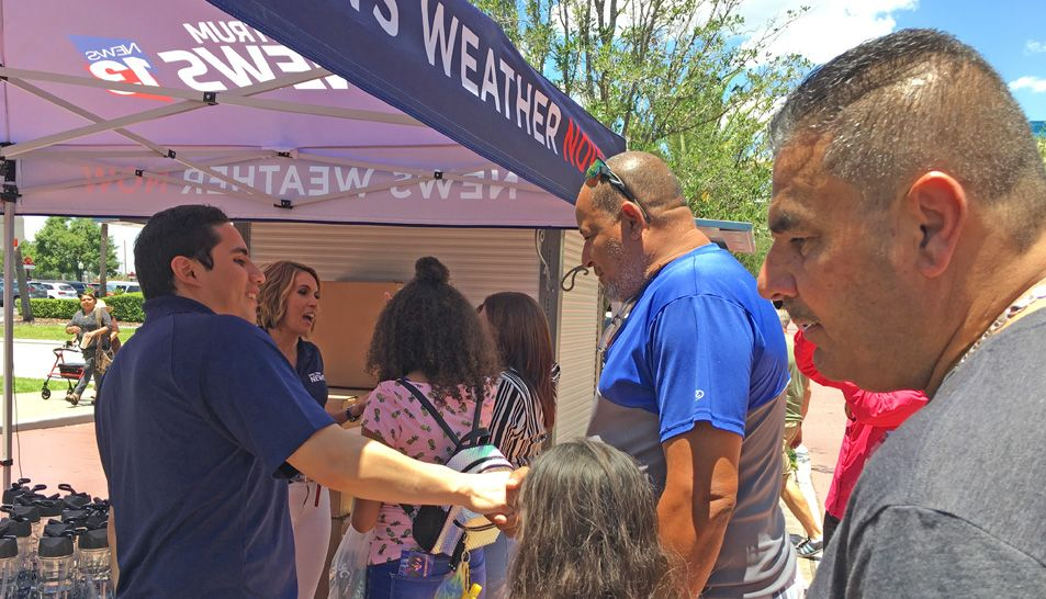 Spectrum News 13 anchor Ybeth Bruzual and reporter Jesse Canales greeted attendees at Latin Fiesta Nights at Old Town and helped them cool down with Spectrum News 13 water bottles.