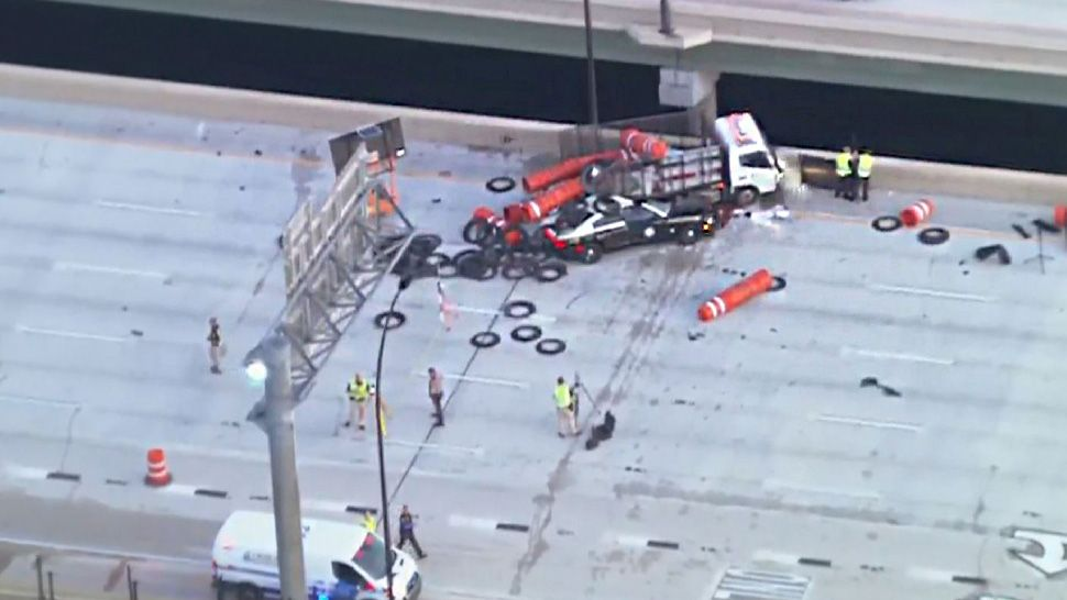 Florida Highway Patrol Trooper Tracy Vickers' car appears to have collided with a truck carrying construction barrels near the Conway Road exit at mile marker 13 over Lake Underhill. (Sky 13)