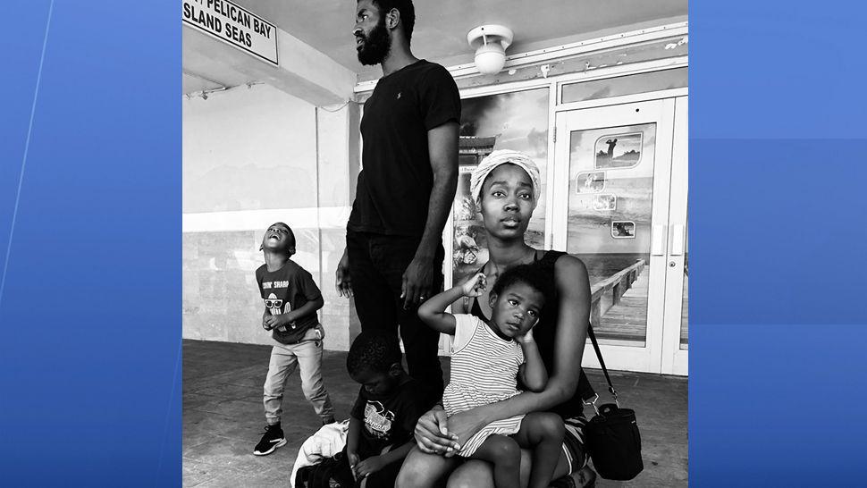This family in the Bahamas survived Hurricane Dorian. (Adam Vance/Spectrum News)