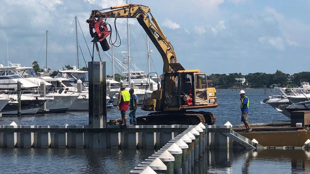 FWC Brings in Barge to Help Move Stuck Manatees