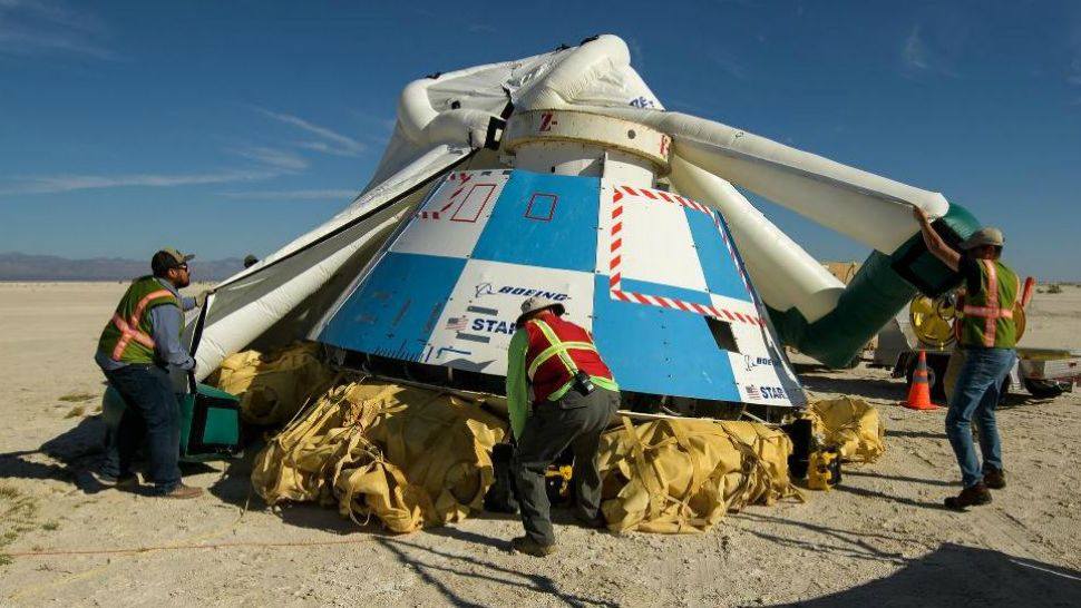 Boeing's Starliner capsule is examined after a test flight. The Starliner is intended to carry astronauts to the International Space Station. (NASA file)