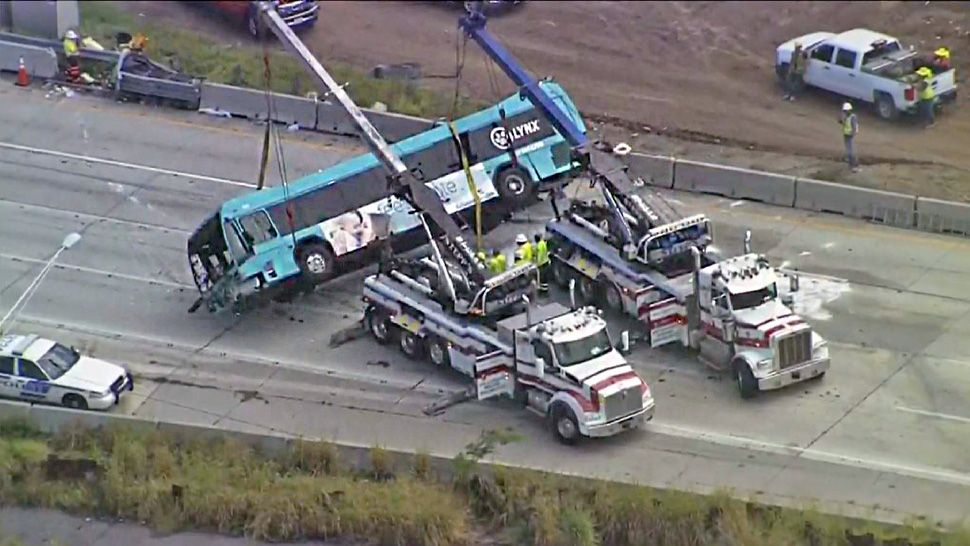 A Lynx bus is right side up after falling on its side on Interstate 4 on Tuesday afternoon. (Sky 13)