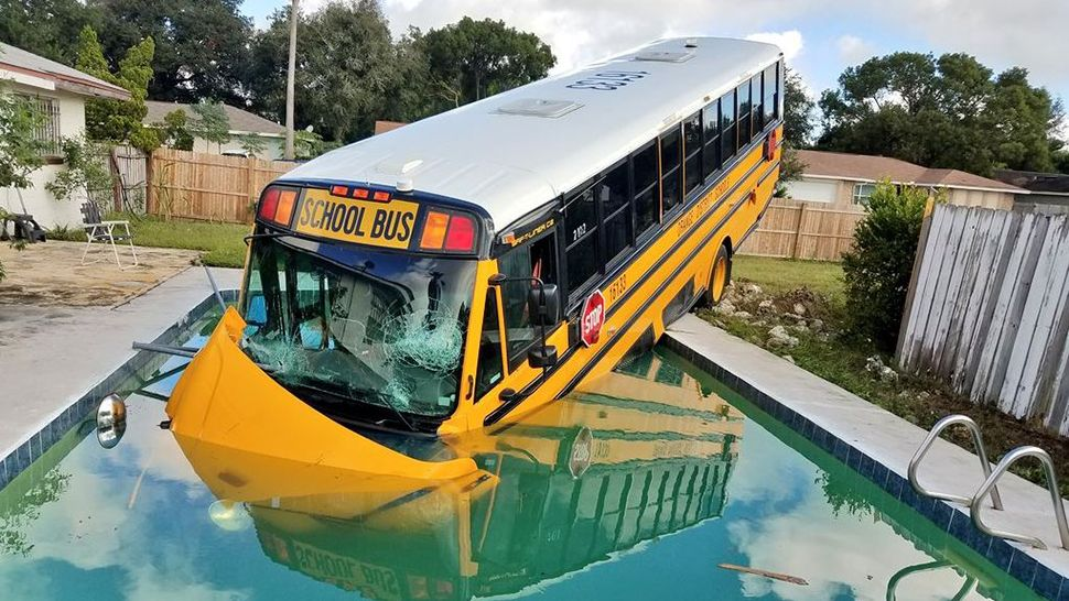 This school bus heading going to Magnolia School crashed into a swimming pool on Friday, October 12, 2018. (Orange County Fire Rescue)