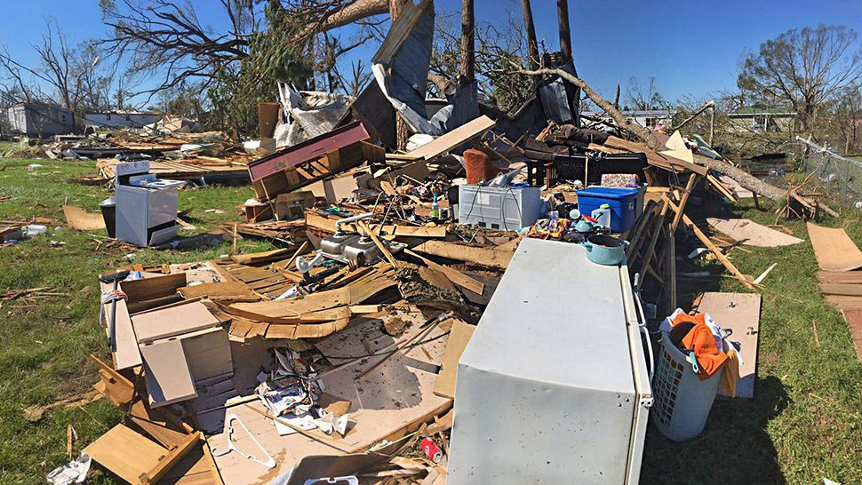 Homes lay in ruins and many people have searched for loved ones within the rubble. However, one family had to escape from home out windows as Hurricane Michael tore apart their home. (Jon Shaban/Spectrum News)