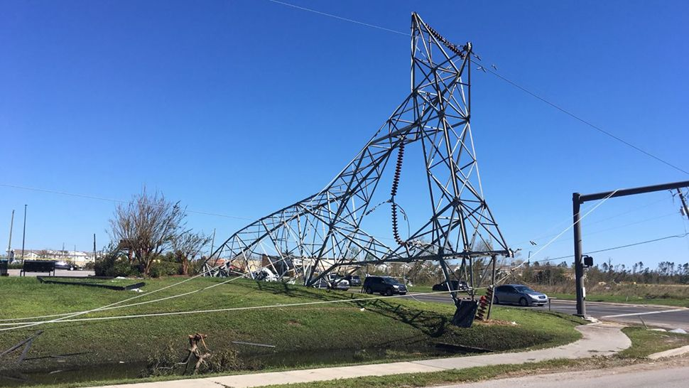 Overhead power lines, like these, have crashed to the ground due to Hurricane Michael.  (Jon Shaban/Spectrum News)