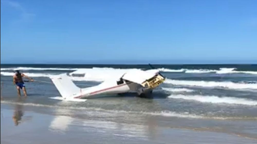 A small plane went down in water off the coast of Daytona Beach Shores on Tuesday afternoon. The pilot was rescued after climbing on a wing, and the plane was hauled onto the beach.