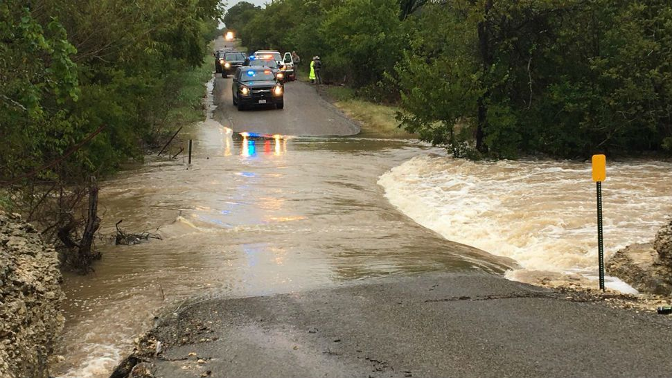 Mother and child rescued during flooding on County Road 252 in Williamson County.