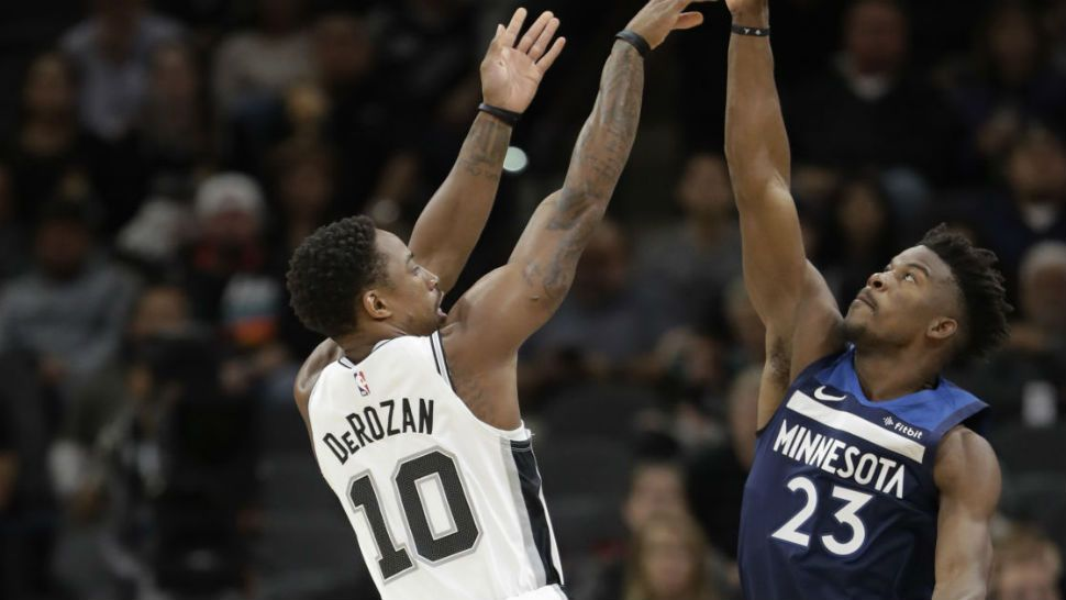 d5dc2fb22616 San Antonio Spurs guard DeMar DeRozan (10) shoots over Minnesota  Timberwolves guard Jimmy Butler
