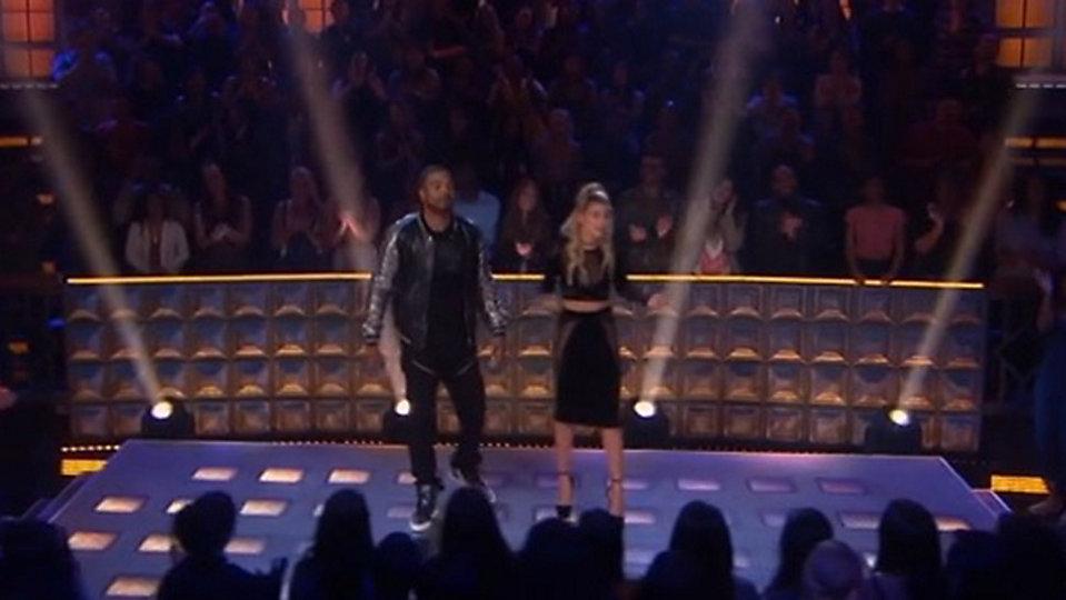 "Method Man and Hailey Baldwin host ""Drop the Mic"" a competition show where celebrities face-off in rap battles. (TBS)"