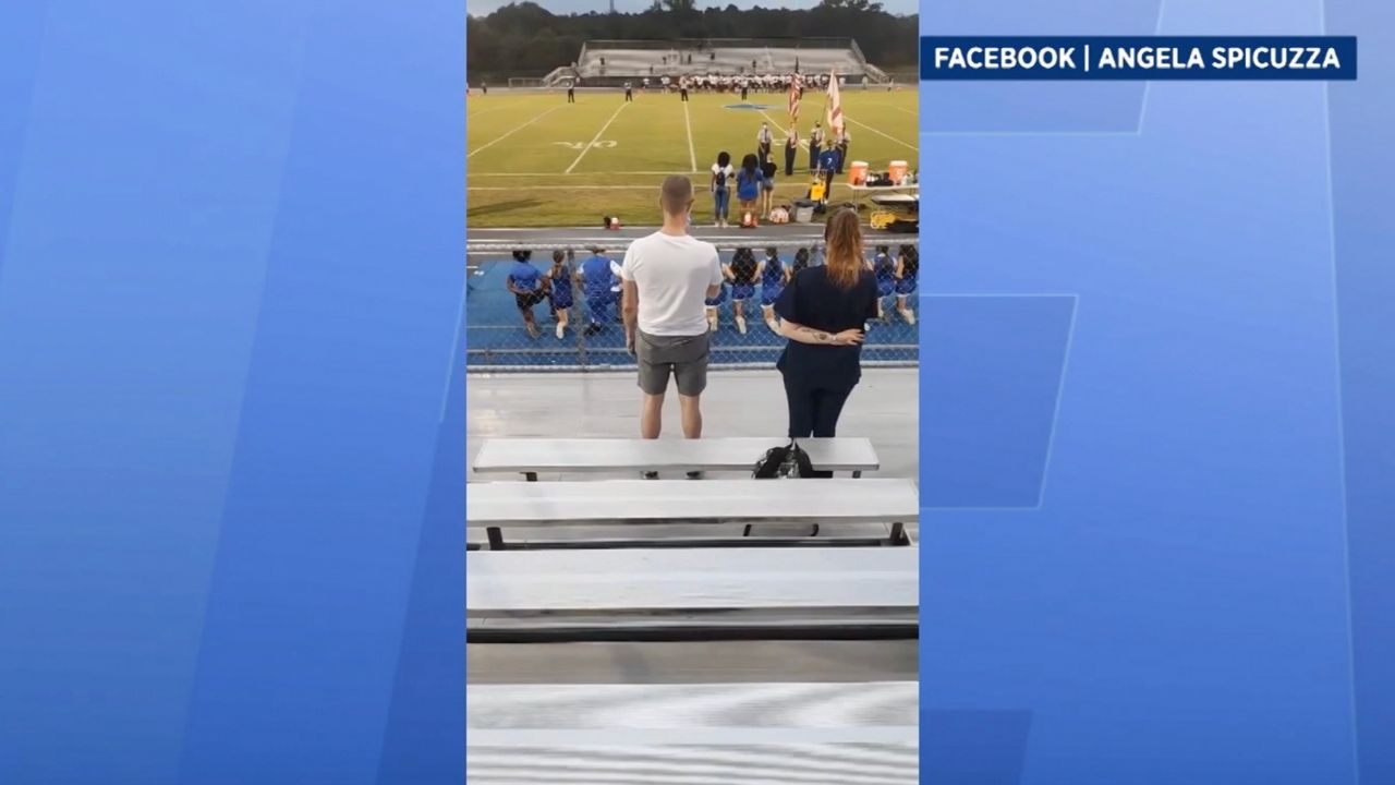 Family Claims Cheerleading Coach Forced Girl to Kneel During National Anthem