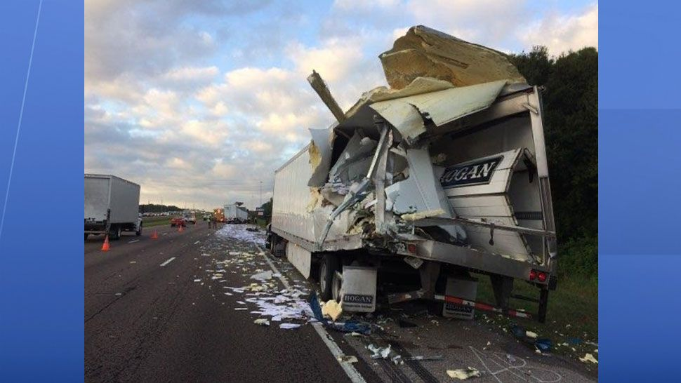 A semi-truck carrying US mail crashed on I-75 Monday morning sending mail across the southbound lanes. (Courtesy of the Florida Highway Patrol)