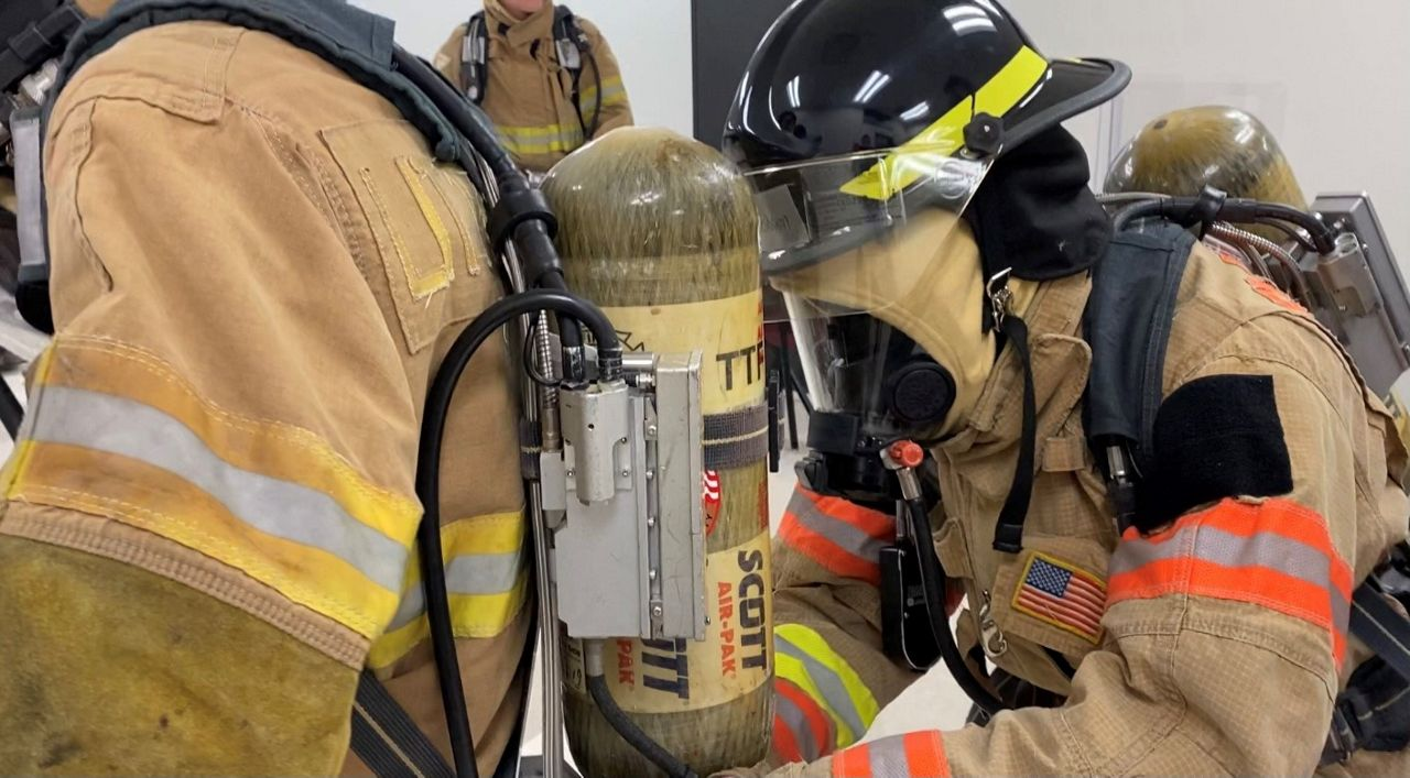 Lewisville High School students go through firefighter training. (Spectrum News)