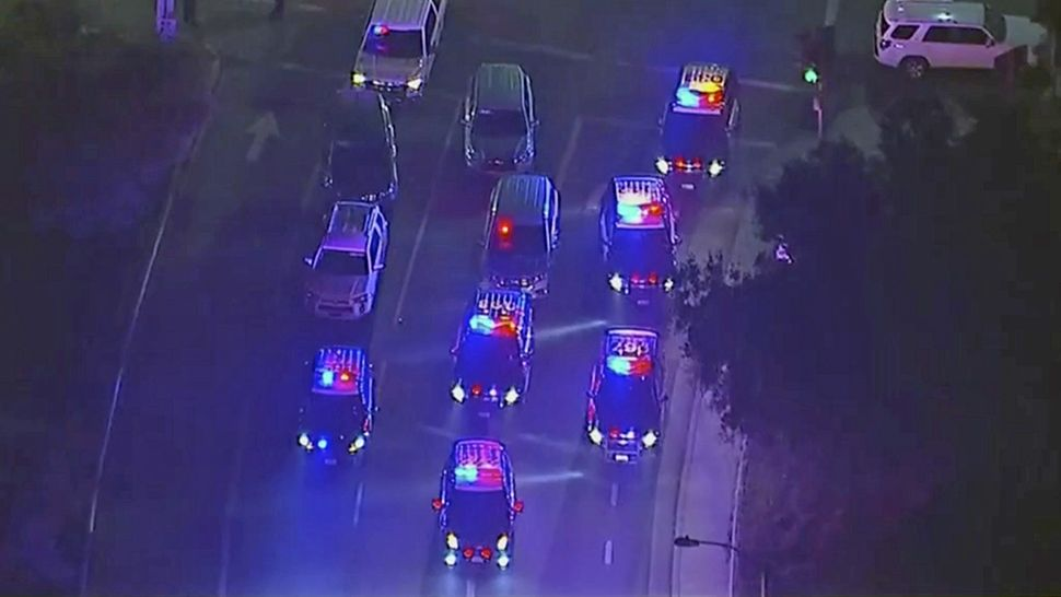 In this image made from aerial video, police vehicles block an intersection in the vicinity of a shooting in Thousand Oaks, California, early Thursday, Nov. 8, 2018. Authorities say there were multiple injuries, including one officer, after a man opened fire in Southern California bar late Wednesday. (KABC via AP)