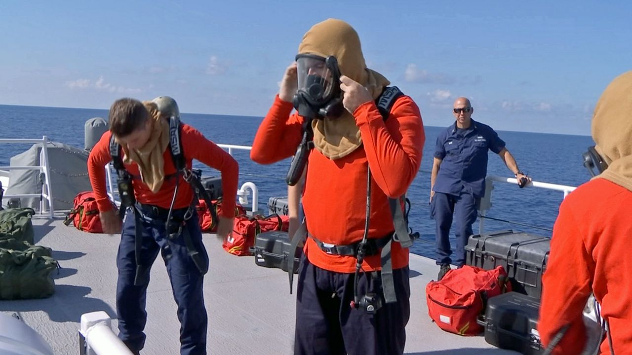 In between patrols, the crew often runs drills to prepare for the unexpected. They are dressing out in fire resistant clothing to prepare for a drill.