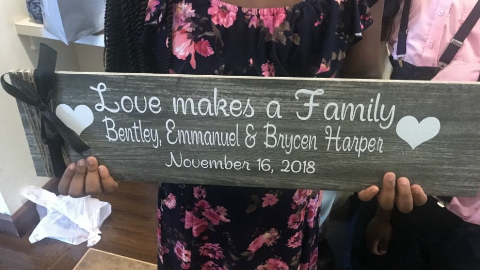 Danielle Harper and the Harper family adopted 3 children at the courthouse in Viera on Friday, November 16, 2018. (Greg Pallone/Spectrum News 13)