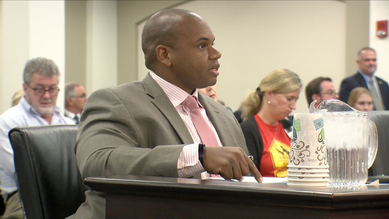 Kentucky Education Commissioner Wayne Lewis testifies in front of the Interim Joint Committee on Education