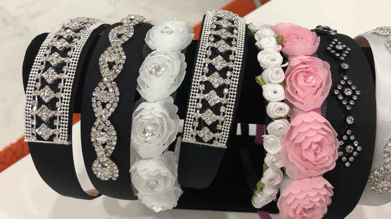 """Samples of Maxine Simeone's """"Sparkles by Maxine"""" headbands and barrettes. (Ashley Paul/Spectrum Bay News 9)"""