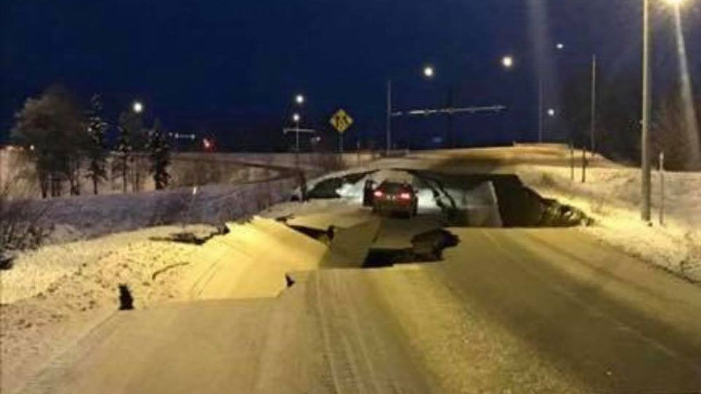 A vehicle is stuck after an earthquake buckles a highway in Anchorage, Alaska Friday. Photos provided by a Spectrum News viewer.