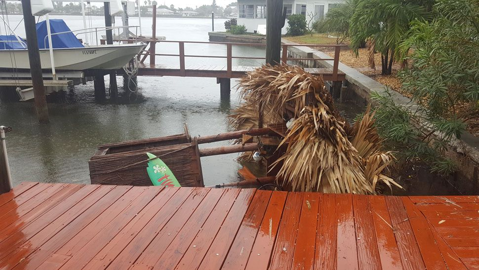 Large Tiki Hut blown from dock into canal off Intercoastal waterway in Madeira Beach (Courtesy of Bill, viewer)