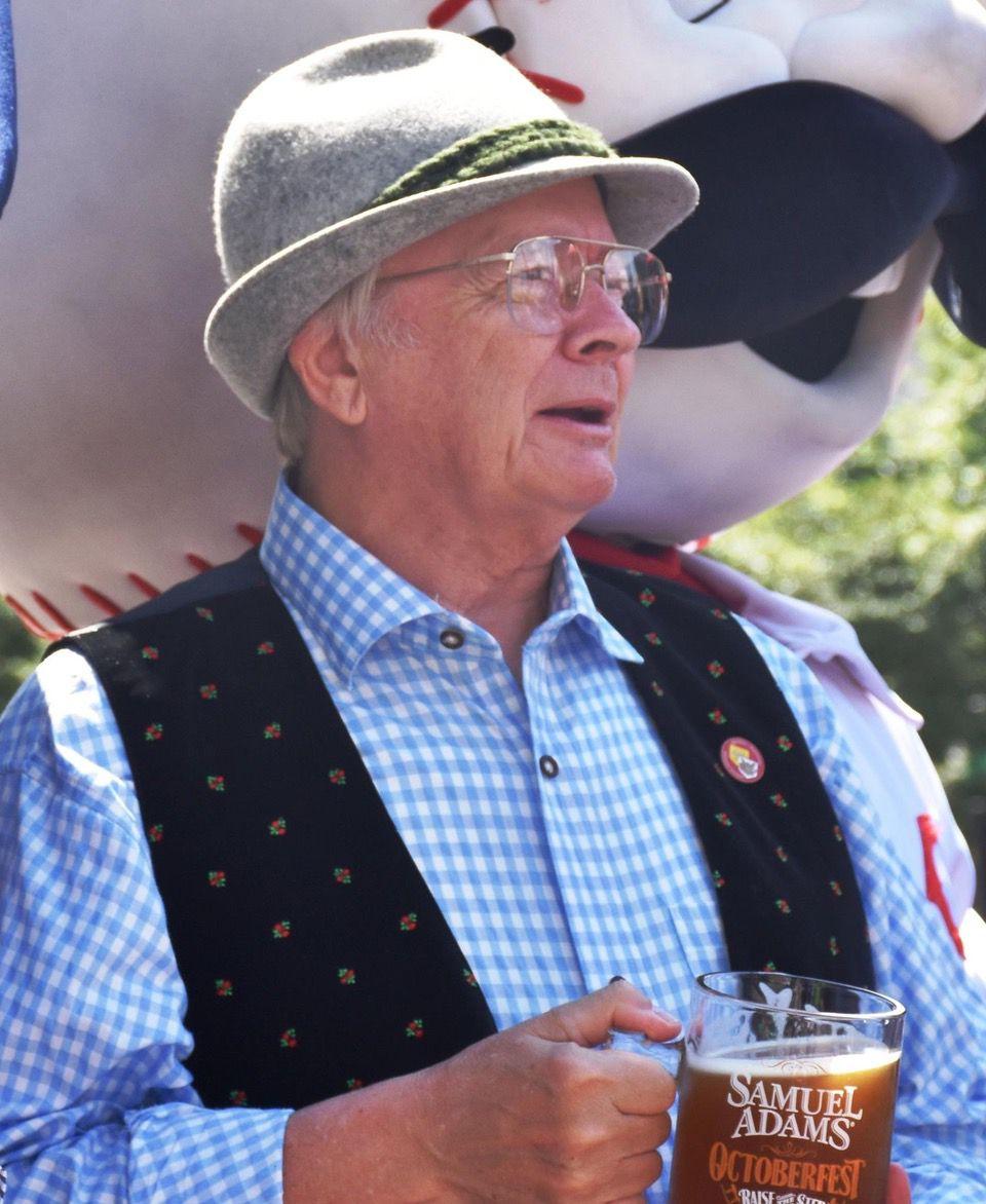 A man in Oktoberfest attire holds a beer glass during Oktoberfest Zinzinnati (Casey Weldon   Spectrum News 1)