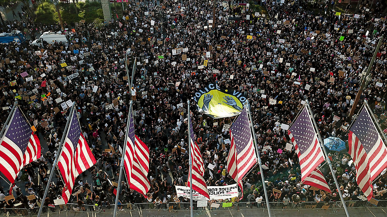 Demonstrators take part in a protest over the death of George Floyd who died May 25 after he was restrained by Minneapolis police, Wednesday, June 3, 2020, in downtown Los Angeles.