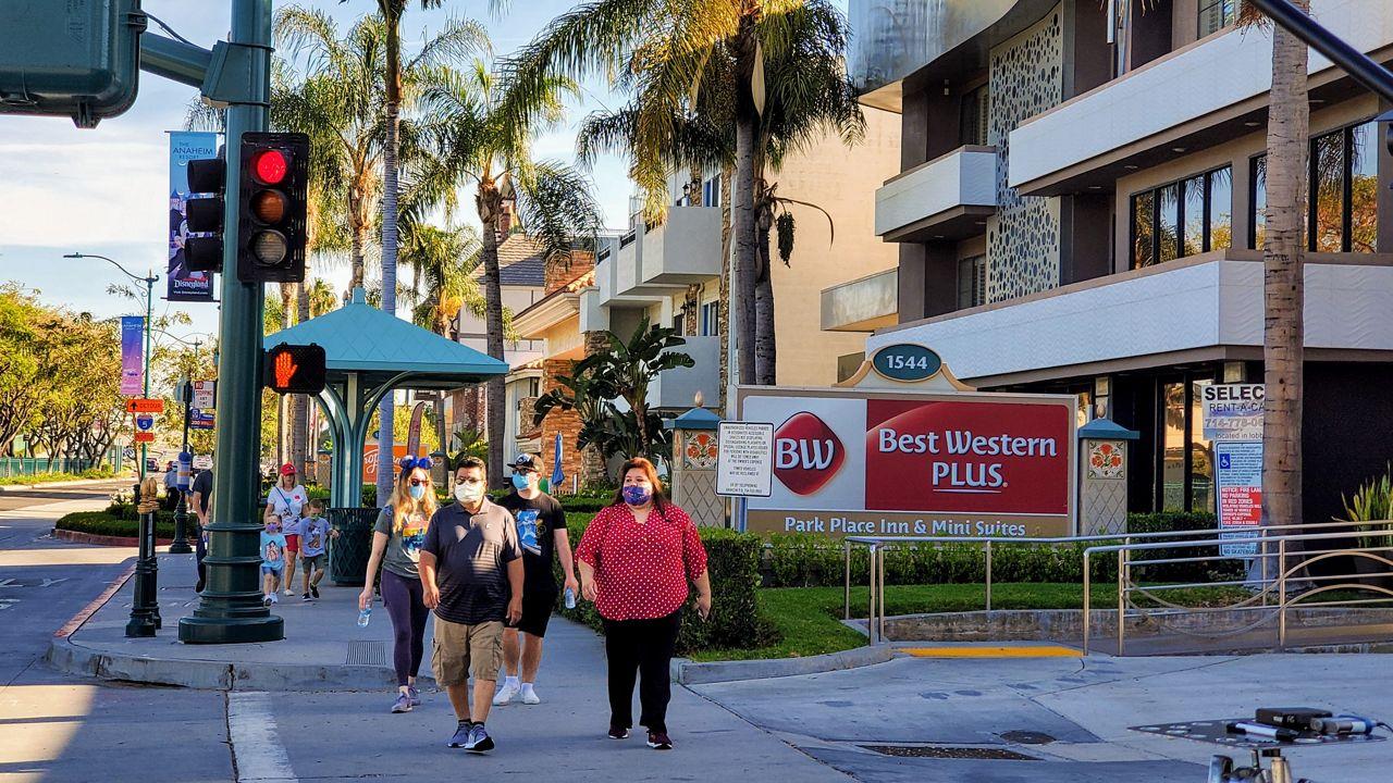 Visitors walk by hotels in Anaheim, Calif. (Spectrum News 1/Joseph Pimentel)