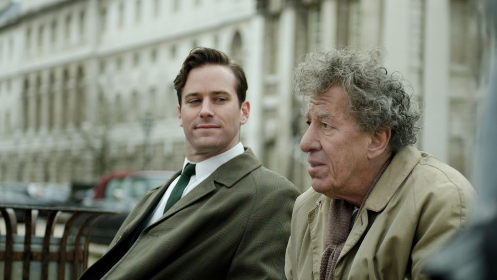 Left to right: Armie Hammer as James Lord and Geoffrey Rush as Alberto Giacometti. Photo by Parisa Taghizadeh, Courtesy of Sony Pictures Classics
