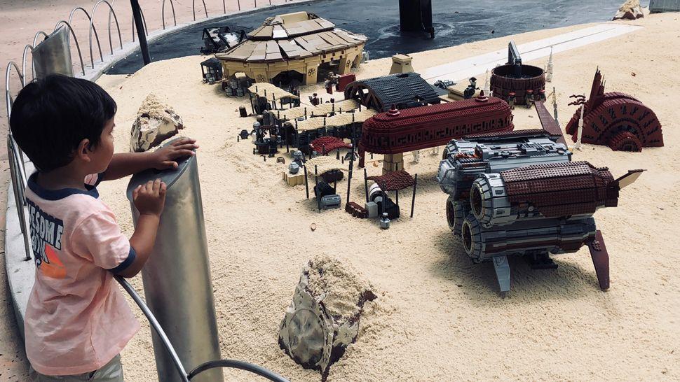 Rey and Finn rush through a junkyard looking for an escape. (Virginia Johnson, staff)