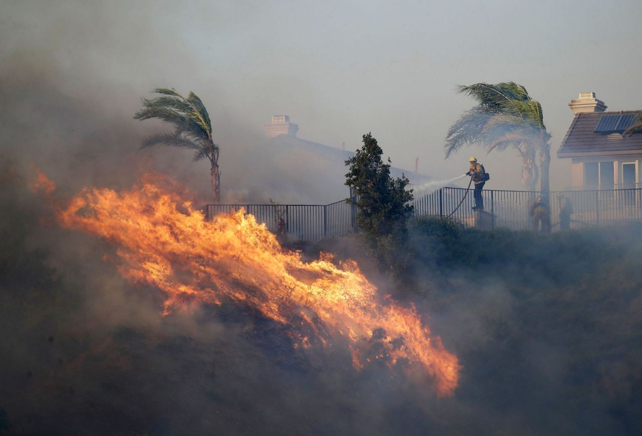Winds dying as crews fight flames in Southern California