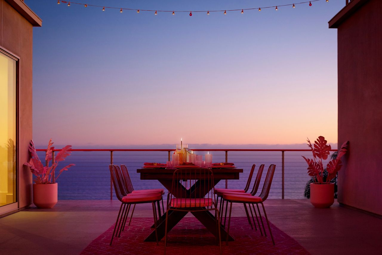 The patio of Barbie's home overlooks the Malibu beach with a meal prepared by a celebrity chef.