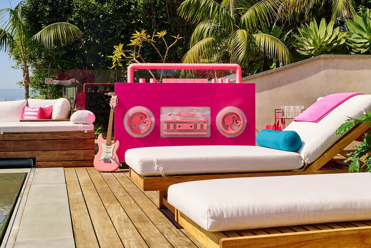 Features an infinity pool overlooking California's coast with a giant Barbie boom box.