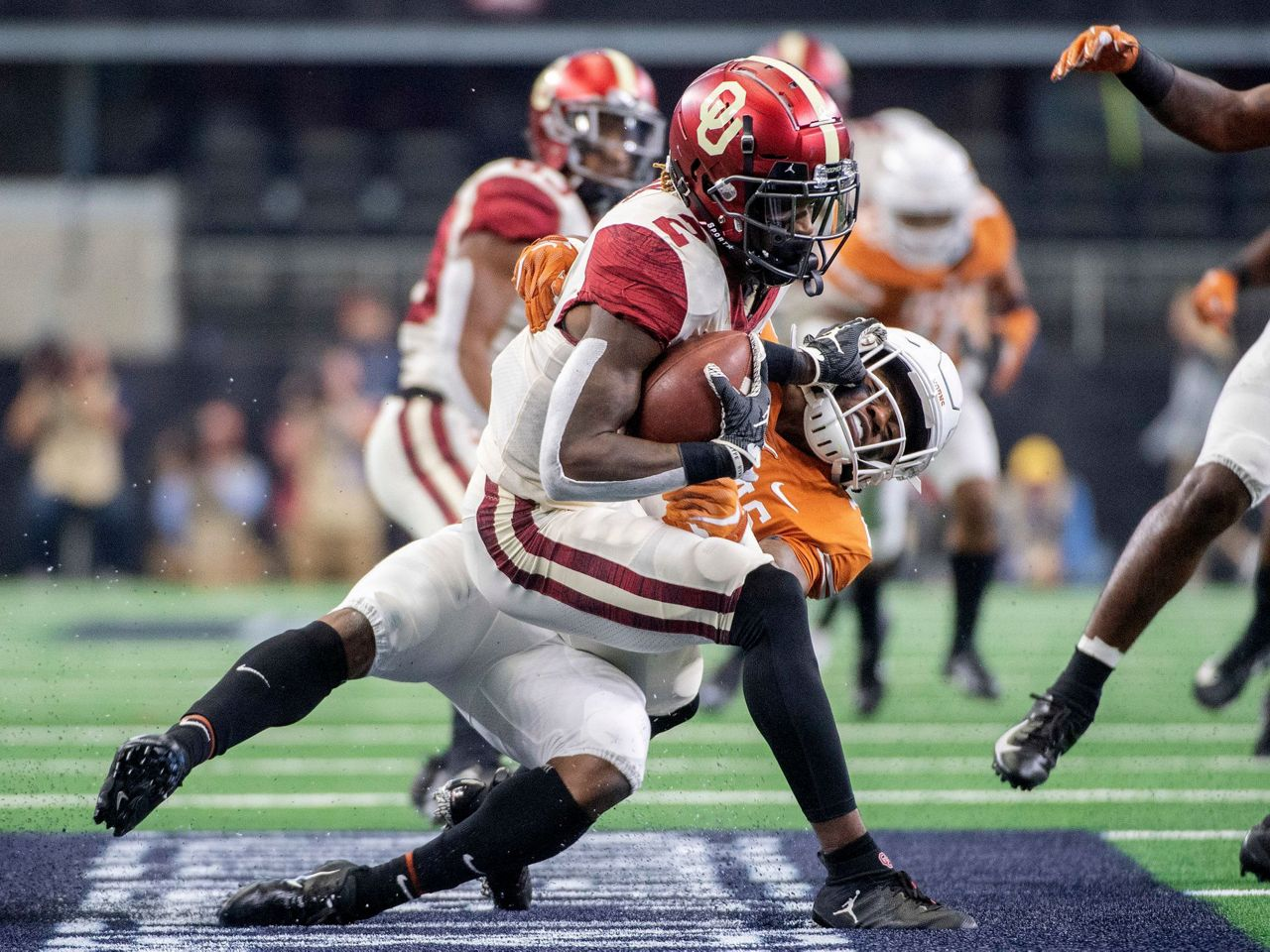 The Latest: Championship Saturday starts with Texas TD