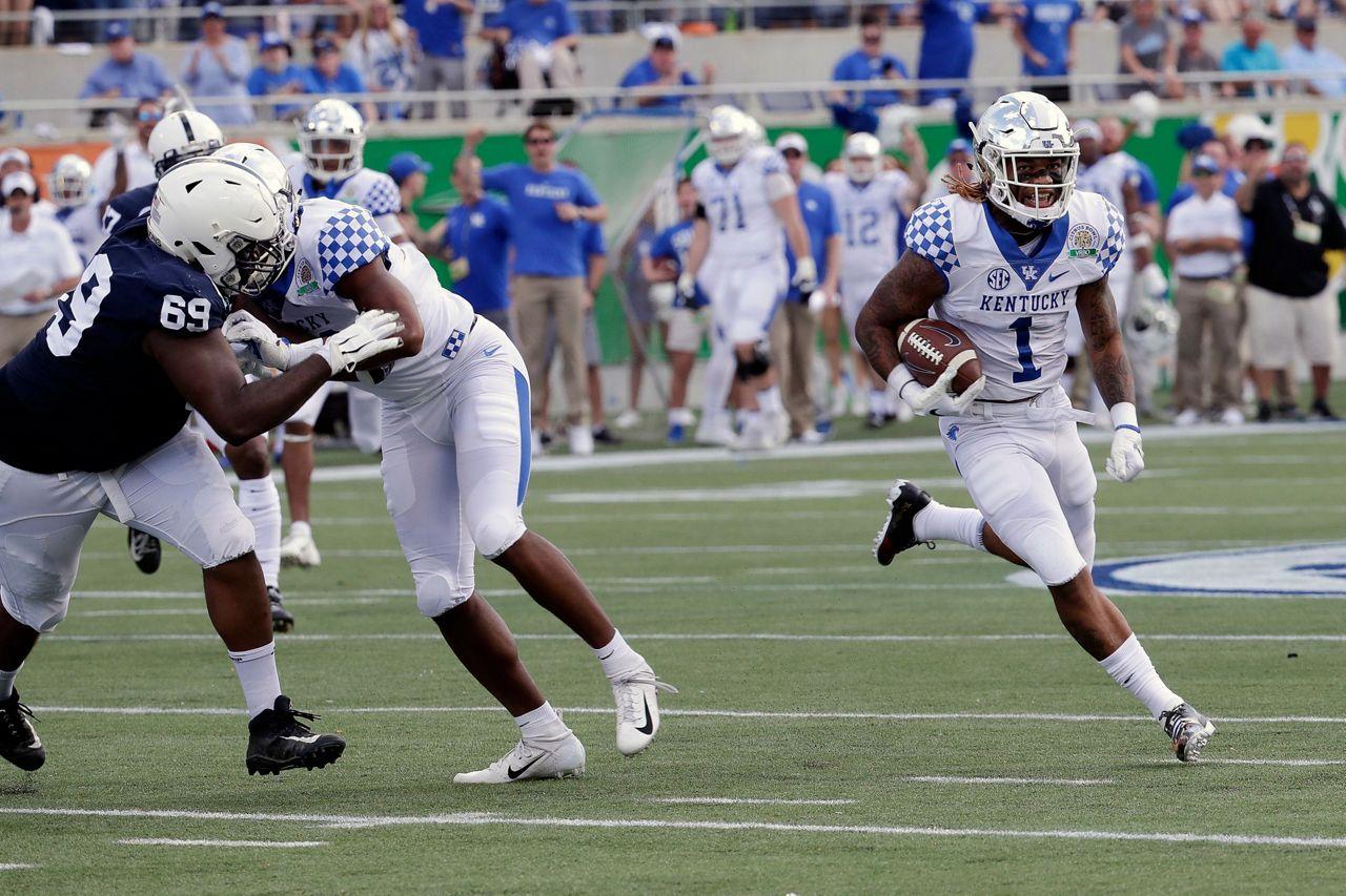 Snell runs wild, No. 16 Kentucky holds off No. 13 Penn State