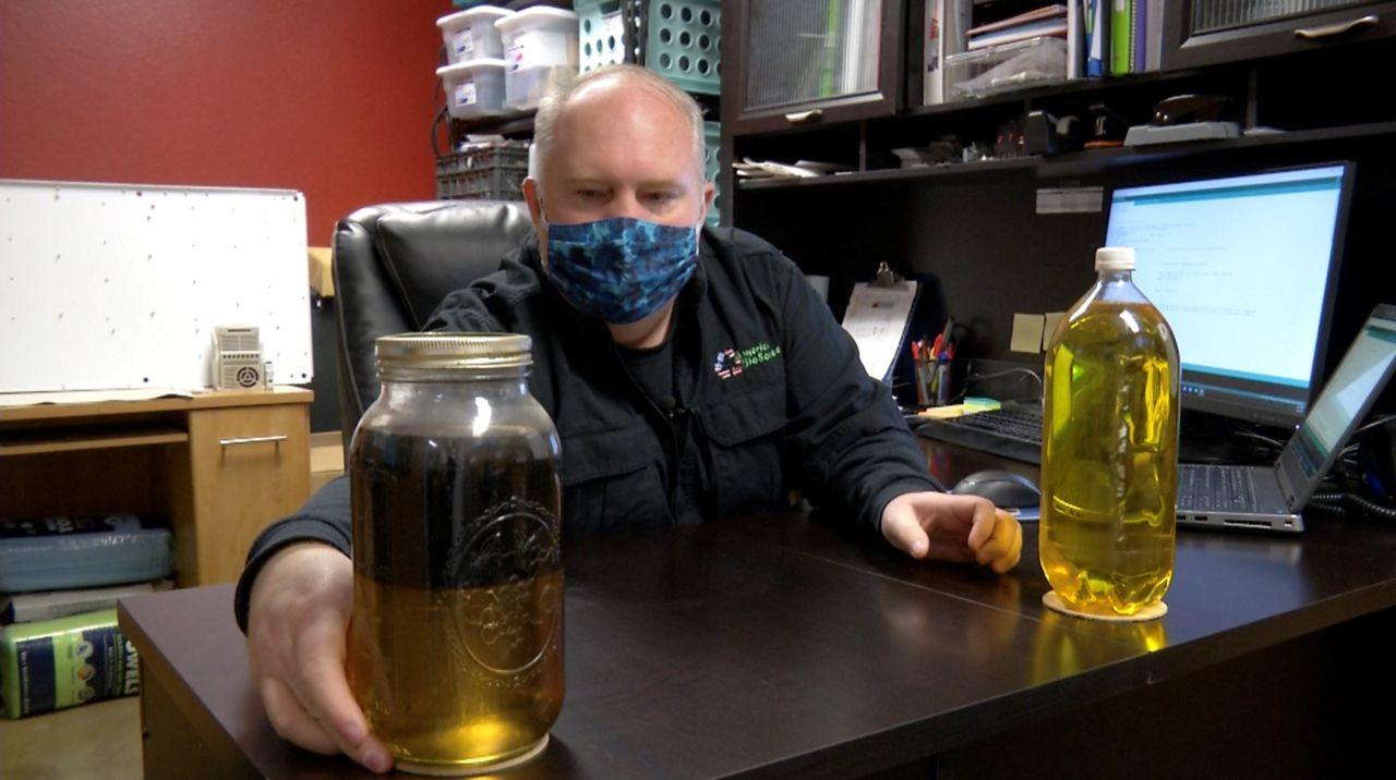 Walter Dobson at American Biosource with biodiesel (Stacy Rickard/Spectrum News 1)