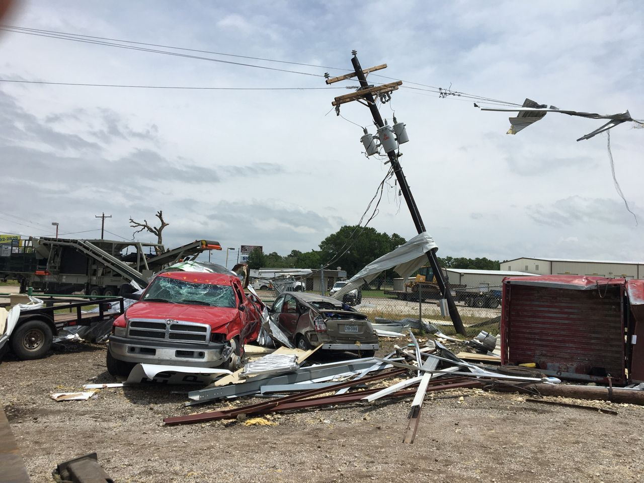 Two vehicles and electric lines were damaged during the tornadoes.