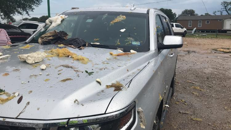 Debris left behind on a car in the wake of 2 Fayette County tornadoes.