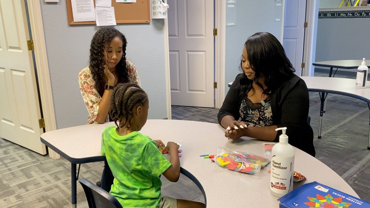 Picture taken at Guiding Light Concepts in Killeen. Elizabeth Brown-Miller and Brandy Collins are chatting as Elizabeth's son plays with a toy. (Spectrum News 1/Olivia Levada)