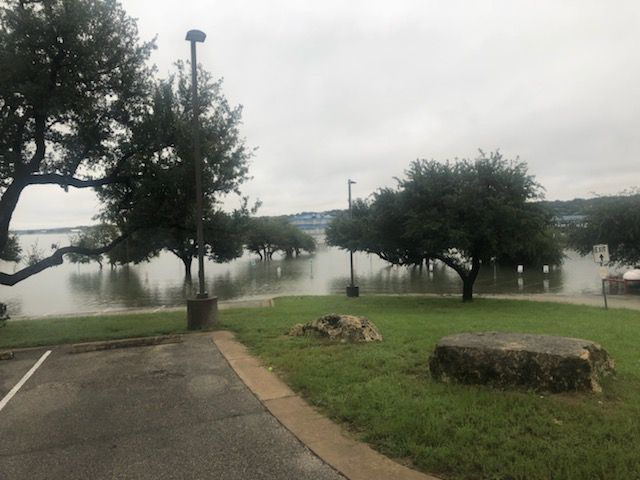 Lake Travis rises to cover the parking lot at Point Venture and the Gnarly Gar Restaurant.