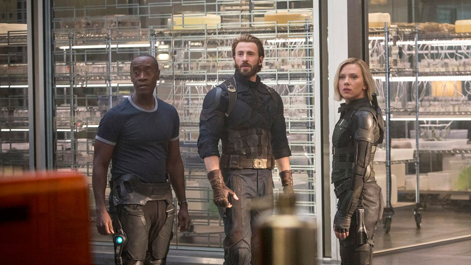 Marvel Studios' AVENGERS: INFINITY WAR. L to R: War Machine/James Rhodes (Don Cheadle), Captain America/Steve Rogers (Chris Evans) and Black Widow (Scarlett Johansson). Photo: Chuck Zlotnick. ©Marvel Studios 2018