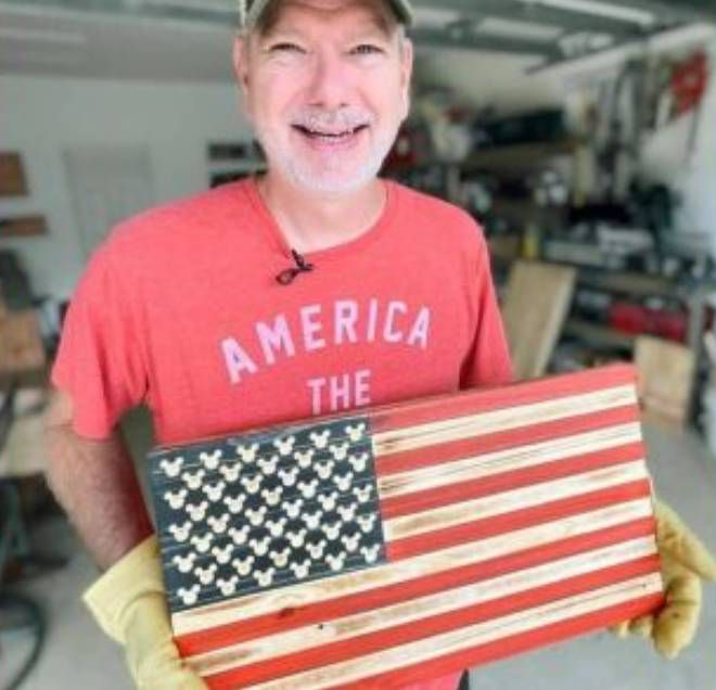 Mark Newman went from a manager at the Disney Vacation Club, to a builder of handcrafted wooden flags. (Justin Soto/Spectrum News 13)